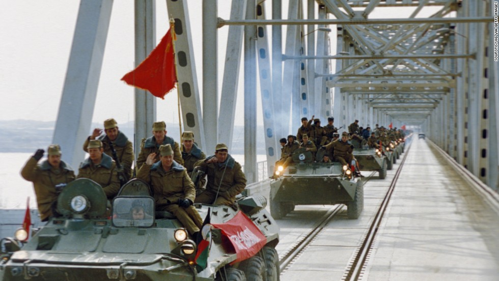 Soviet troops cross the Soviet-Afghan border along the bridge over the Amu Darya river near the town of Termez, Uzbekistan, during their withdrawal from Afghanistan on February 6, 1989. The Soviet Union invaded Afghanistan in 1979 as communist Babrak Karmal seized control of the government. U.S.-backed Muslim guerrilla fighters waged a costly war against the Soviets for nearly a decade.