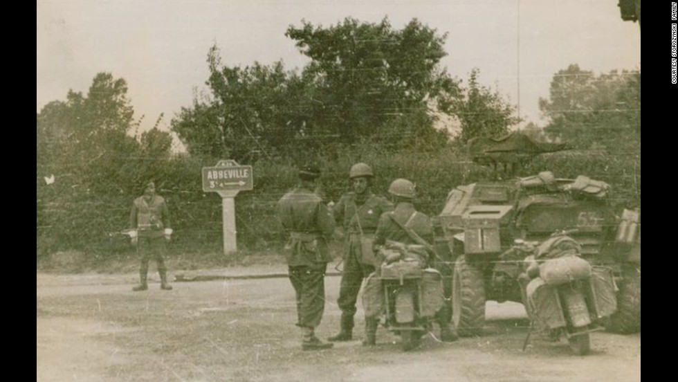 Dionizy Storozynski, third from left, talks with members of his regiment near Abbeville, France.