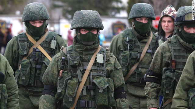 Pro Russian soldiers guard Ukraine's infantry base in Perevalne, Ukraine, Tuesday, March 4, 2014. Russian President Vladimir Putin said Moscow reserves the right to use all means to protect Russians in Ukraine as U.S. Secretary of State John Kerry was on his way to Kiev. Tensions remained high in the strategic Ukrainian peninsula of Crimea with troops loyal to Moscow firing warning shots to ward off protesting Ukrainian soldiers. AP Photo/Sergei Grits