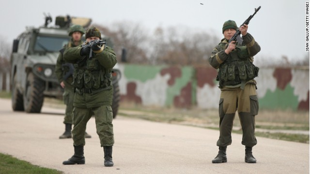 Russian troops fire warning shots