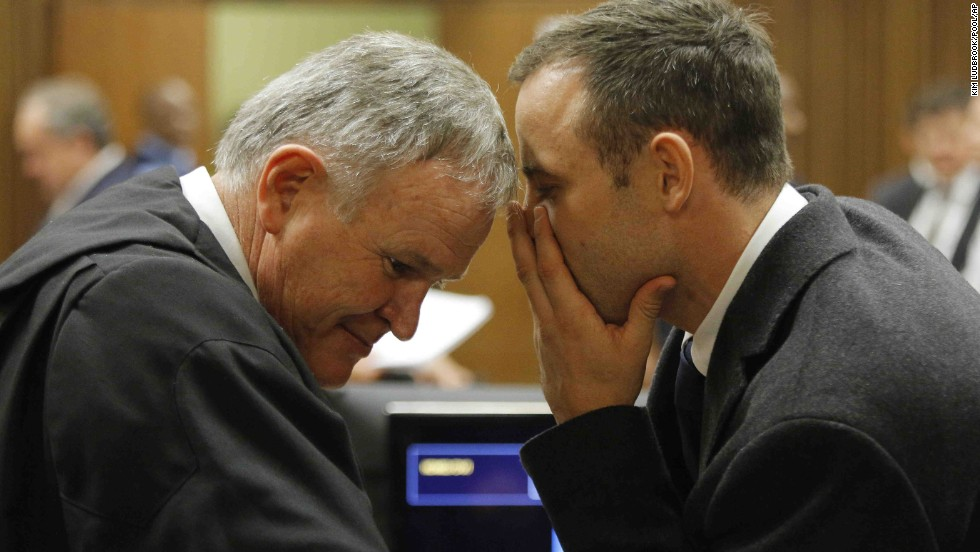 Pistorius talks with Roux inside the court on March 4.