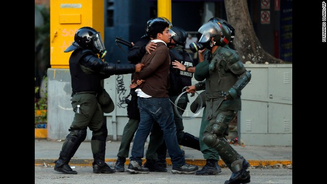 Bolivarian National Guard officers detain a protester March 4 in Caracas.