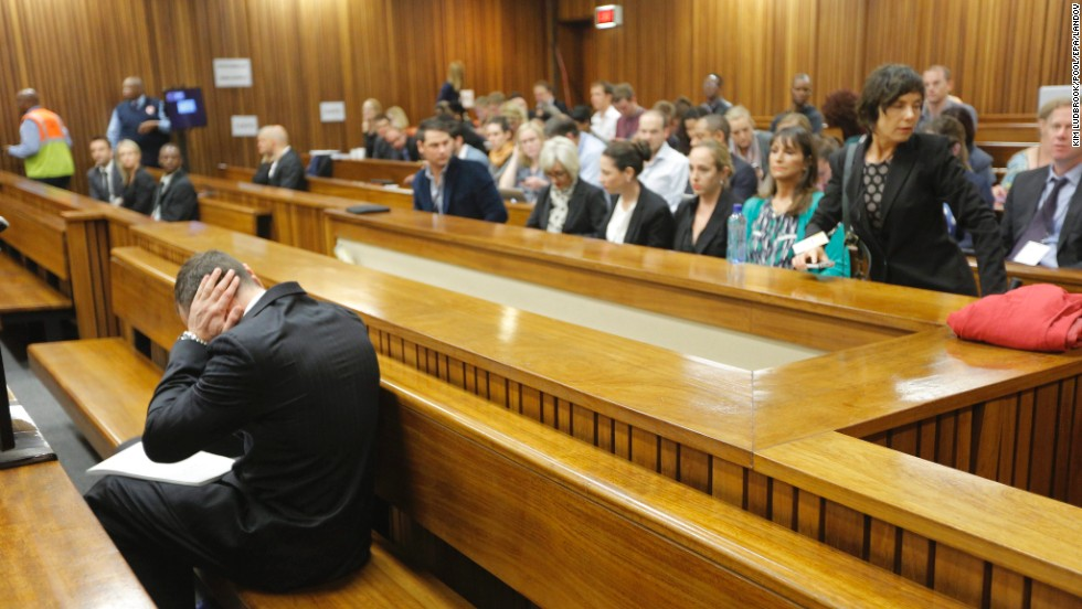 "Oscar Pistorius covers his ears on Tuesday, March 4, during <a href=""http://www.cnn.com/2014/03/03/africa/gallery/pistorius-2014-trial/index.html"">his murder trial</a> in Pretoria, South Africa. Pistorius, the first amputee to compete at an able-bodied Olympics, is accused of murdering his girlfriend, Reeva Steenkamp, on February 14, 2013."