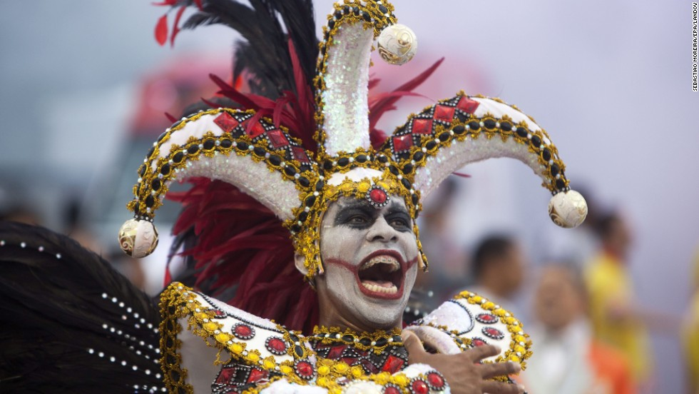 "A member of the ""Grupo Especial Tom Maior"" samba school performs during carnival celebrations in Sao Paulo, Brazil, on Saturday, March 1."