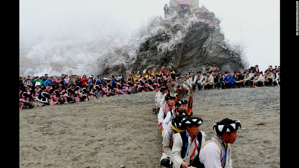 Qiang people take part in a Guairu Festival celebration in Puxi Township, China, on Sunday, March 2. The Guairu Festival pays homage to mountain deities to wish for an auspicious year.