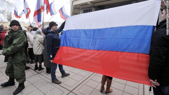 Pro-Russian activists hold a Russian flag during a rally in Simferopol on March 6, 2014. Pro-Moscow authorities in Crimea on March 6 asked Russian President Vladimir Putin to examine a request for their region to join the Russian Federation, which will be put to a referendum on March 16. AFP PHOTO/ GENYA SAVILOV (Photo credit should read GENYA SAVILOV/AFP/Getty Images)