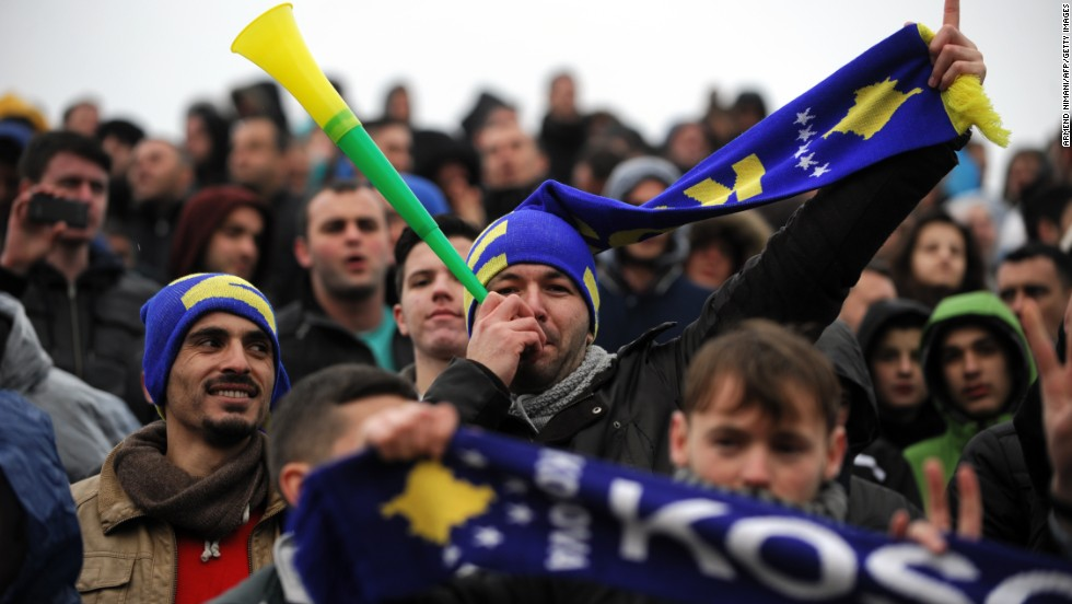MITROVICA, KOSOVO - MARCH 6: A supporter of the Kosovo team blows into a vuvuzela during a friendly football match against Haiti. Six years after declaring independence from Serbia, Kosovo drew 0-0 in their FIFA-approved debut on the international stage.