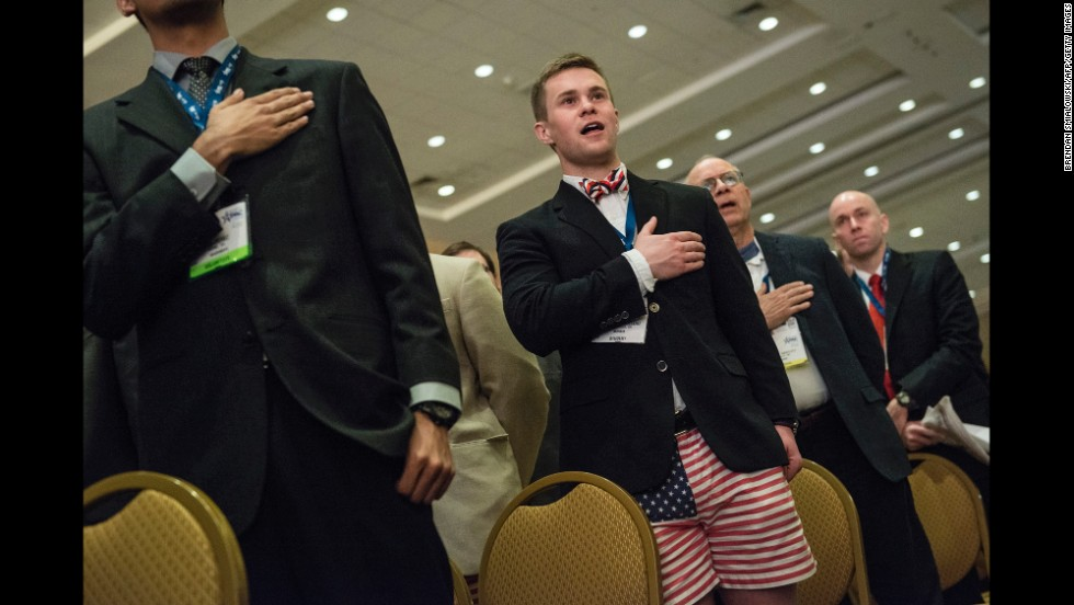 Attendees sing the National Anthem as CPAC opens on Thursday.