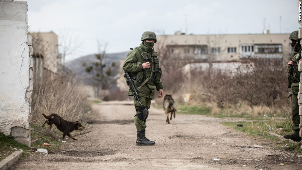 A member of the Russian military patrols around Perevalne on March 6.