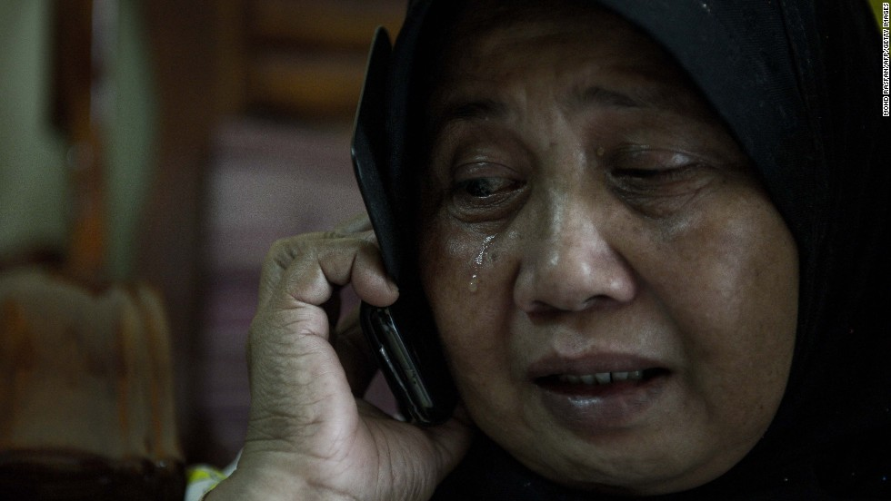 A relative of two missing passengers reacts at their home in Kuala Lumpur on March 8, 2014.