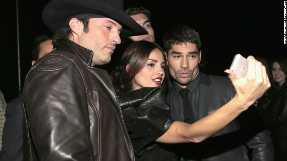 "Filmmaker Robert Rodriguez, left, poses with ""From Dusk Till Dawn: The Series"" actors Eiza Gonzalez and D.J. Cotrona on March 8."