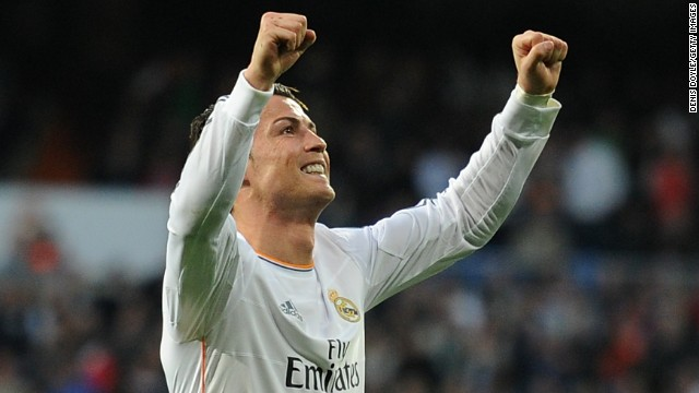 Cristiano Ronaldo raises his arms in triumph after scoring the opener for Real Madrid against Levante.