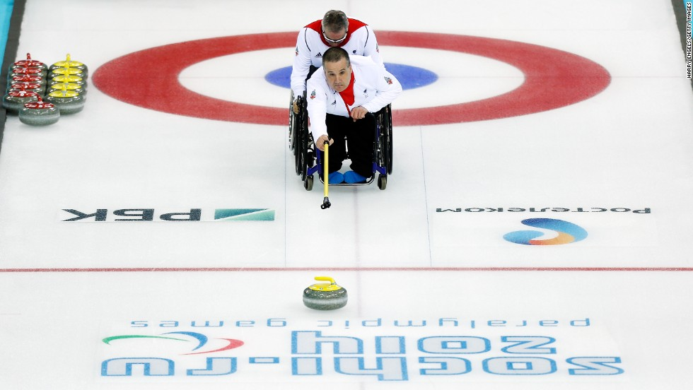 Bob McPherson of Great Britain competes in a mixed curling match versus Sweden on March 9.