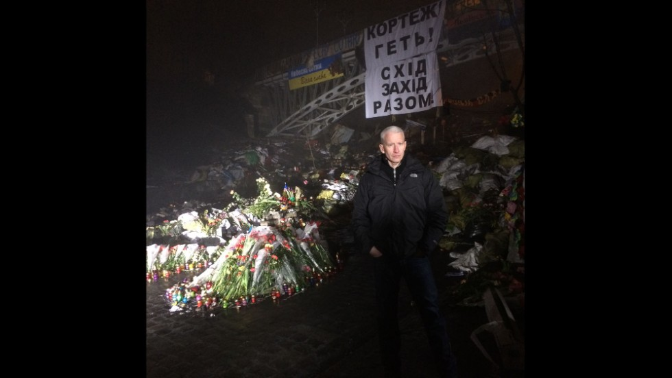KIEV, UKRAINE:  CNN's Anderson Cooper reports from Kiev's Independence Square on March 6.  Photo by CNN's Khalil Abdallah.