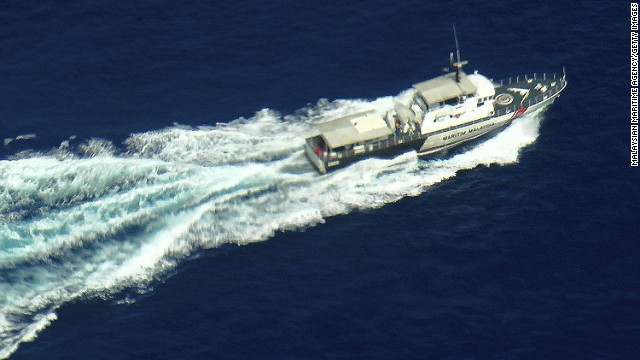 AT SEA,  KELANTAN COAST, MALAYSIA - MARCH 09:  In this handout provided by the Malaysian Maritime Agency, a patrol vessel of Malaysian Maritime Enforcement Agency searches during the search and rescue mission for Malaysia Airlines flight MH370 on March 9, 2014 off the Kelantan coast, Malaysia. Potential sightings of possible airliner debris and a possible oil slick in the sea off Vietnam have not been officially verified or confirmed as investigative teams continue to search for the whereabouts of missing Malaysia Airlines flight MG370 and its 293 passengers, travelling from Kuala Lumpur to Beijing. The airliner was reported missing on the morning of March 8 after the crew failed to check in as scheduled.  Relatives of the missing passengers have been advised to prepare for the worst as authorities focus on two passengers on board travelling with stolen passports.  (Photo by Malaysian Maritime Agency via Getty Images)