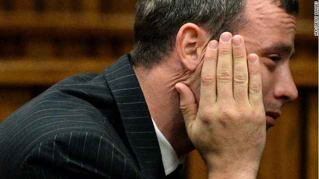 Oscar Pistorius reacts during a hearing on the sixth day of his trial for the 2013 murder of his girlfriend, on March 10, 2014 at the high court in Pretoria.