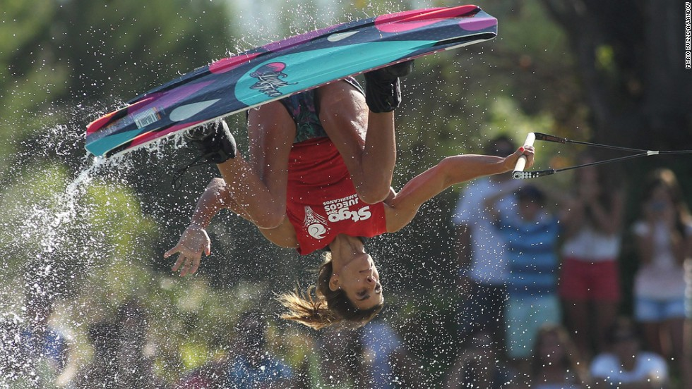 Roberta Rendo of Argentina flips upside down Saturday, March 8, during the wakeboard competition at the South American Games in Santiago, Chile.