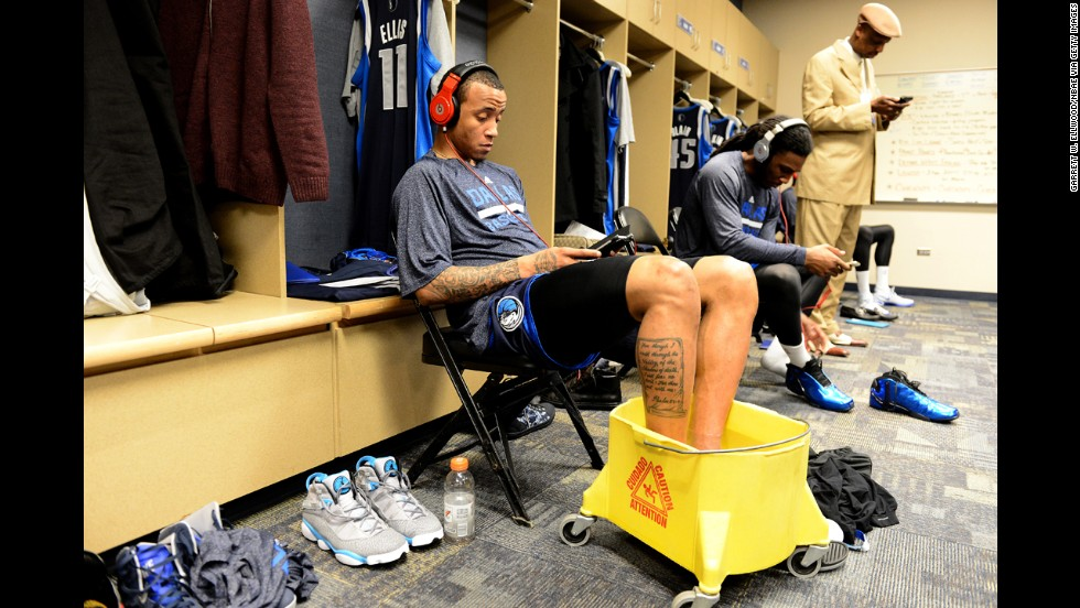 Monta Ellis, a guard for the NBA's Dallas Mavericks, soaks his feet in the locker room before the game at Denver on Wednesday, March 5.