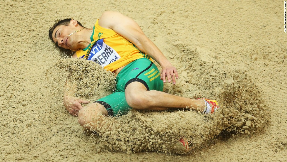 Fabrice Lapierre of Australia lands Friday, March 7, during the men's long jump competition at the IAAF World Indoor Championships in Poland.
