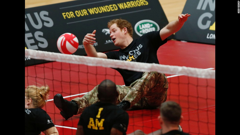 Britain's Prince Harry plays a game of sitting volleyball in London on Thursday, March 6, during the launch of the Invictus Games for wounded troops.