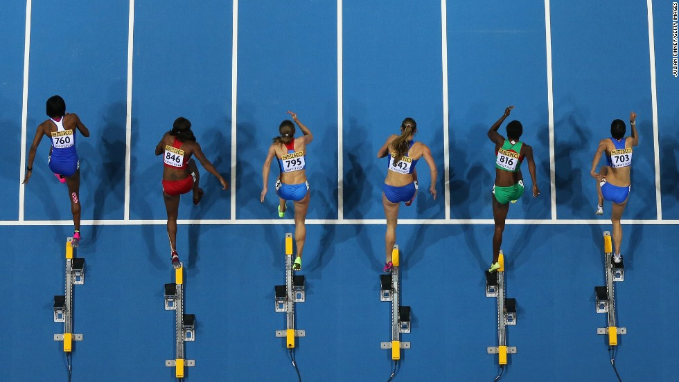 Hurdlers leave the blocks during a 60-meter race Friday, March 7, at the IAAF World Indoor Championships in Poland.