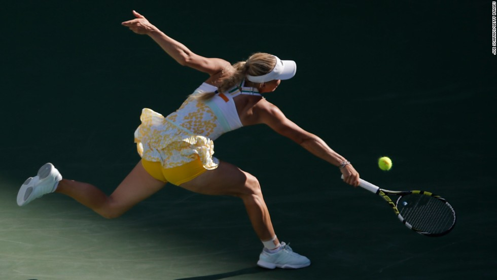 Caroline Wozniacki lunges for a backhand Sunday, March 9, during a tennis match against Yaroslava Shvedova at the BNP Paribas Open in Indian Wells, California.