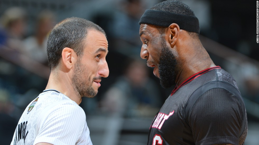 Manu Ginobili of the San Antonio Spurs, left, faces off with LeBron James of the Miami Heat during an NBA basketball game Thursday, March 6, in San Antonio.
