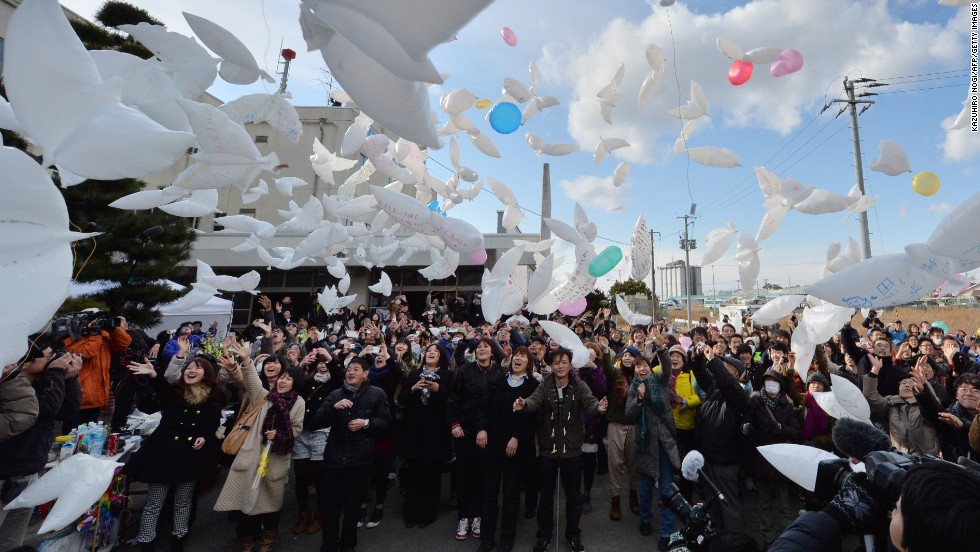 NATORI, JAPAN - MARCH 11: Dove-shaped balloons are released into the air during a memorial service for tsunami victims on the third anniversary of the massive earthquake that hit northern Japan. Nearly 19,000 people died in the aftermath of the disaster.