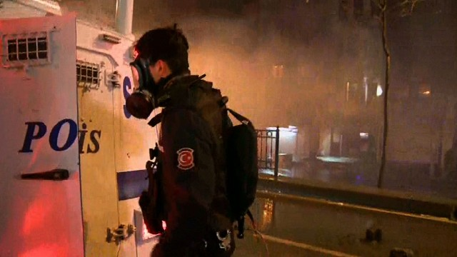 CNN crew caught in police tear gas