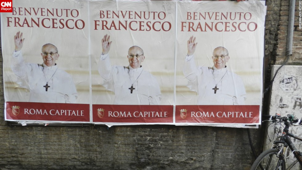 Posters in Rome welcomed the new pope after his inauguration.