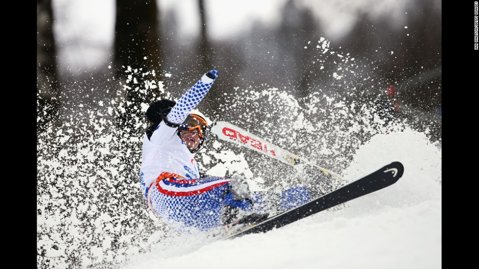 Aleksandr Akhmadulin of Russia crashes in the men's slalom on March 13.