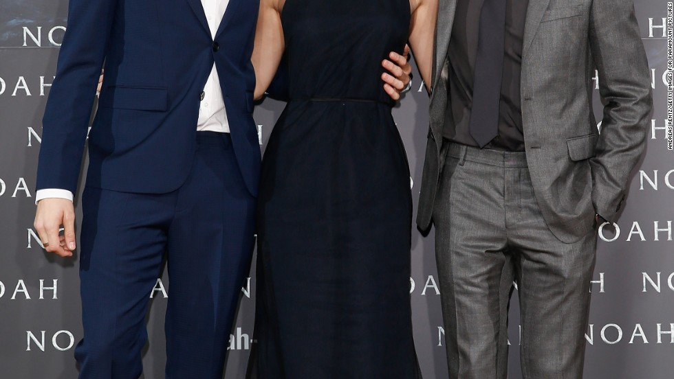 "Emma Watson embraces her ""Noah"" co-stars Douglas Booth (left) and Logan Lerman (right) at the Berlin premiere of the film on March 13."