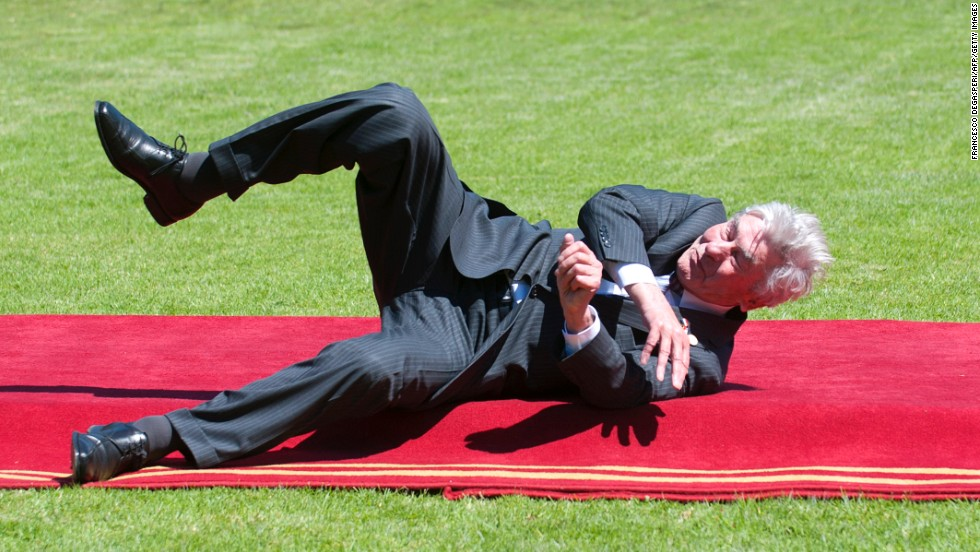 Former Dutch Prime Minister Ruud Lubbers falls after tripping on the red carpet Tuesday, March 11, at the presidential palace in Vina del Mar, Chile. He was one of many dignitaries attending the swearing-in ceremony for Chilean President Michelle Bachelet.