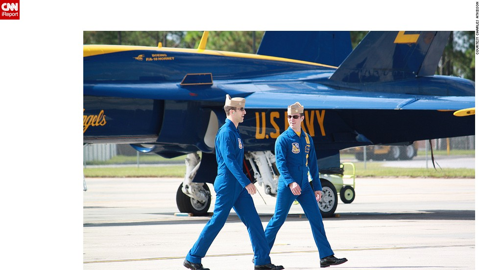 Two pilots converse at the Naval Air Station.