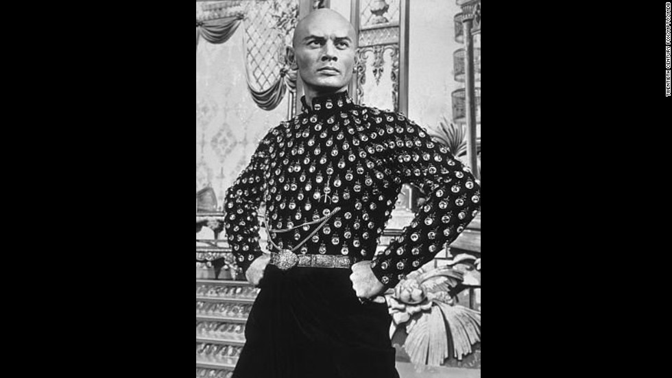 "Russian-born Yul Brynner plays the King of Siam in the 1956 musical ""The King and I."""