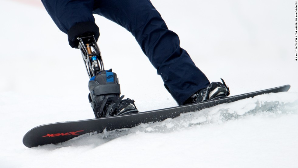 A snowboarder with a lower limb prosthesis competes on March 14.