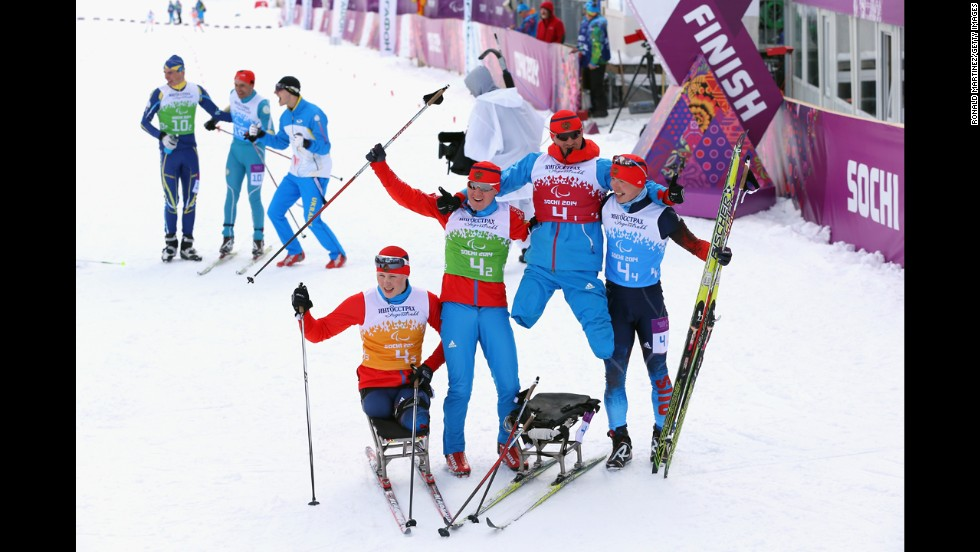 Grigory Murygin, left, Vladislav Lekomtcev, Roman Petushkov and Rushan Minnegulov of Russia celebrate after winning the 4 x 2.5-kilometer open relay cross-country skiing event on March 15.