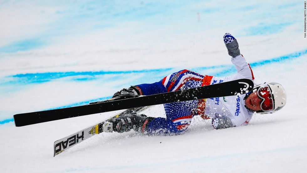 Aleksandr Akhmadulin of Russia crashes in the men's giant slalom standing on March 15.