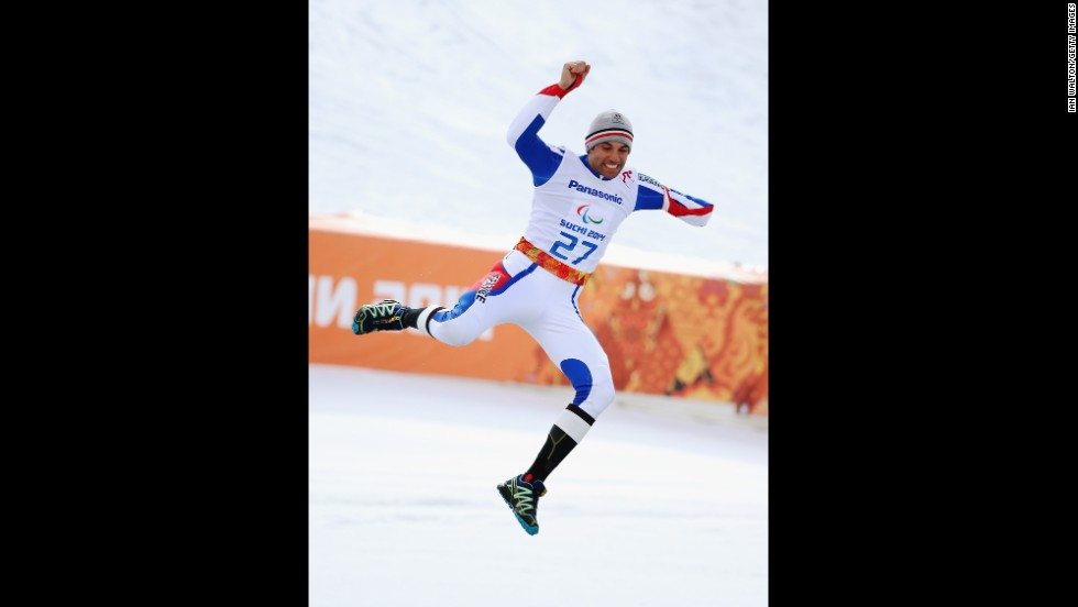 Vincent Gauthier-Manuel of France celebrates winning the gold medal in the giant slalom standing during day eight of the Sochi 2014 Paralympic Winter Games.