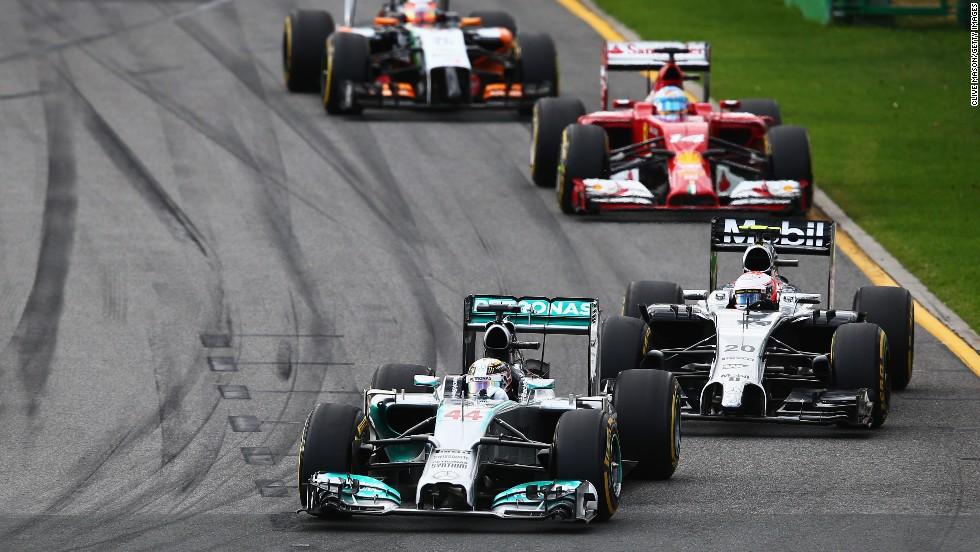 Cars bunch up behind Lewis Hamilton who quickly slipped back through the field from pole and retired after three laps with an engine power fault.