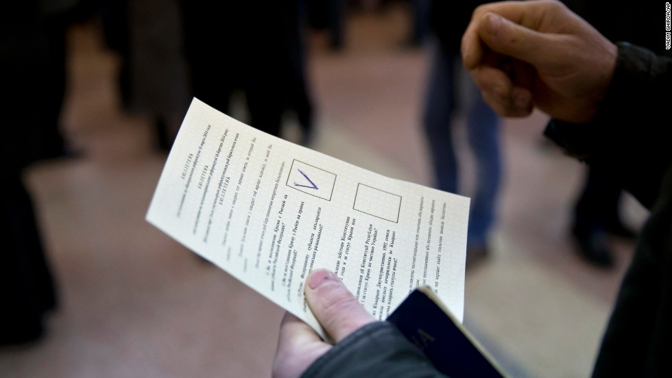 A man holds a ballot after casting a vote in favor of separation from Ukraine in the Crimean referendum in Simferopol, Ukraine, on March 16.