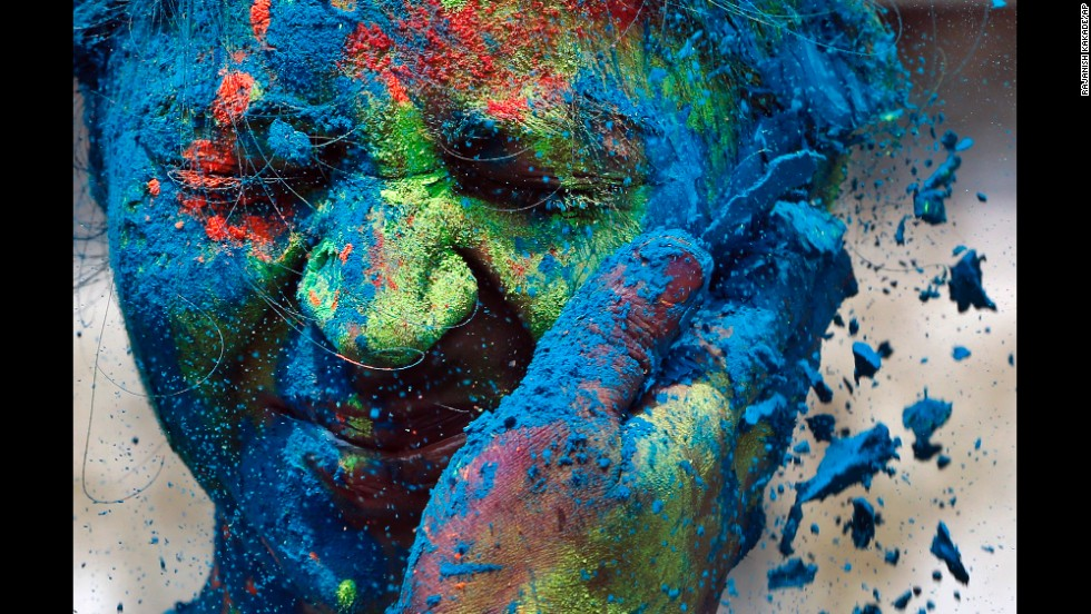 A man smears the face of a woman during Holi celebrations in Mumbai, India, on Monday, March 17.