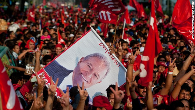 Supporters of Salvador Sanchez Ceren celebrate his victory during the presidential run-off election on March 15, 2014.