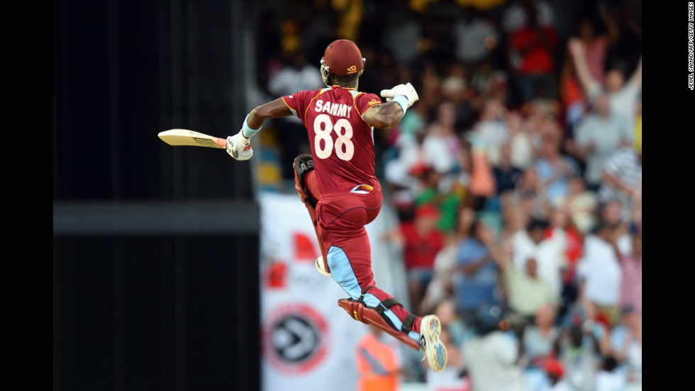 Darren Sammy, captain of the West Indies cricket team, leaps in the air after hitting the final runs to win the second T20 match against England on Tuesday, March 11, in Bridgetown, England.