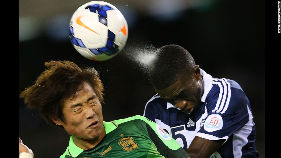 Sweat sprays off the head of Jason Geria of the Melbourne Victory as he heads the ball away from Choi Bo-Kyung of Joenbuk Hyundai Motors during an Asian Champions League match in Melbourne on Wednesday, March 12.