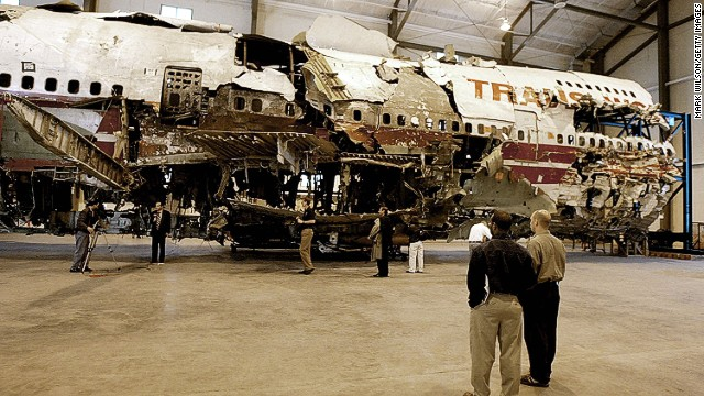 Members of the press examine a 93-foot section of the TWA Flight 800 fuselage at the NTSB Academy in 2004.