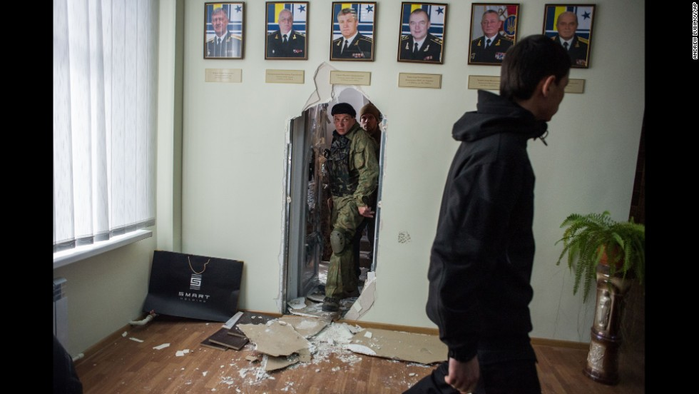 Pro-Russian forces walk inside the Ukrainian navy headquarters in Sevastopol on March 19.