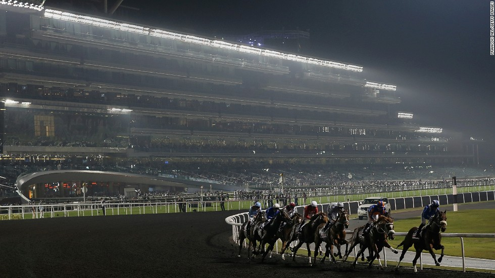 "Described as a ""land scraper,"" the planet's largest grandstand looms in the background during the 2013 Dubai World Cup meeting."