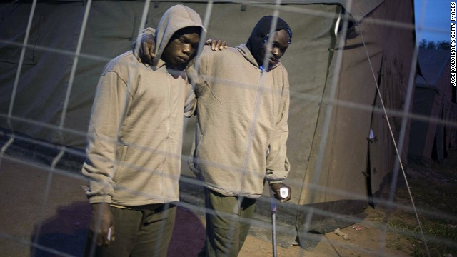 Immigrants walk between freshly erected tents in The Spanish enclave of Melilla on March 18, 2014.