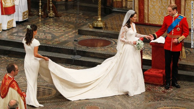 Britain's Prince William and his wife Kate, Duchess of Cambridge, are accompanied by her sister and maid of honor, Pippa Middleton, as they leave their wedding service in April 2011 in London's Westminster Abbey.